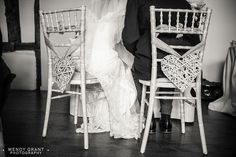 Old-Luxters-Barn-Wedding-Photographer-vintage-wedding-bride-and-groom-on-heart-chairs