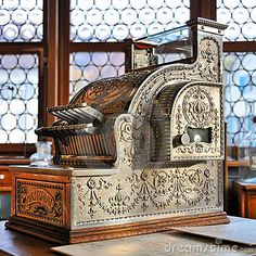 This Antique Cash Register is stunning and those windows!