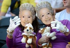 bahahahaha Two fans of England's national football team wearing a mask of Queen Elizabeth II