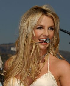 Britney performing at On Air With Ryan Seacrest in 2004.