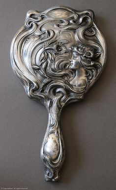 Art Nouveau mirror .  Great idea for a keepsake gift for someone special.