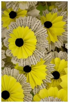 handcrafted paper sunflowers ...  layered rosettes .... largest rosette from upcycled paper book, dictionary, newspaper ... could also ubcycle brown bags for the center ...
