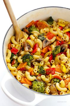 Colorful roasted vegetables are tossed with creamy (and healthier!) mac and cheese in this delicious recipe.  You'll love it!