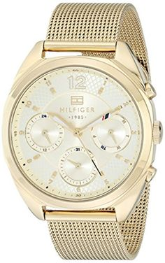 Casual watch, Japanese quartz movement, Multifunction featuring 24-hour, day and date subdials, Polished gold-tone hands with red/white/ #navy accents, Polished g...