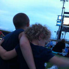 Tessa & Hunter cuddling at the movies @ the baseball stadium.