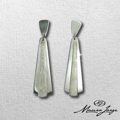 Brincos em prata 925 feito a mão.