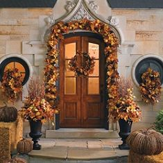 i always want to decorate our front door like this for all holidays.  must find a less expensive way