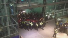 Protestors break through police lines at Kings Cross St Pancras. Protest in solidarity with refugees