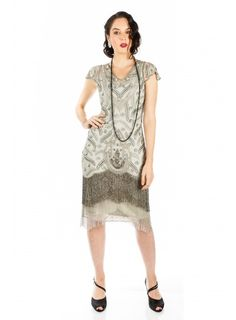 Create a sparkling mirage with this Art Deco Fringe Party Dress in Grey Silver. Thousands of dazzling glass beads and pearl sequins outshine the competition, with the long beaded-glass fringe providing an extra layer of hypnotic movement and reflection. Flapper Style Dresses, Flapper Party, Day Dresses, Vintage Inspired, Party Dress, Art Deco, Sequins, Reflection, Competition