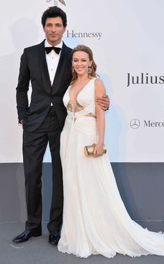Kylie Minogue and Andres Velencoso in Roberto Cavalli at the amfAR Gala 2013 in Cannes....