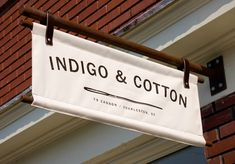 Indigo & Cotton Signage. LOVE this. Very outside the box. Probably won't work for our current project, but perhaps one day.