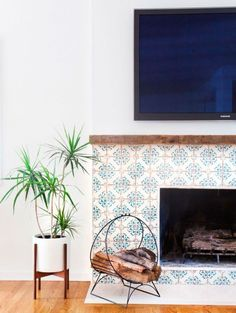 Fireplace with hand painted tiles in a California eclectic home. design by Amber Interiors photo by Tessa Neustadt Fireplace Surrounds, Fireplace Design, Tiled Fireplace, Fireplace Shelves, Farmhouse Fireplace, Victorian Fireplace, Tile Around Fireplace, Ceiling Shelves, Fireplace Tile Surround