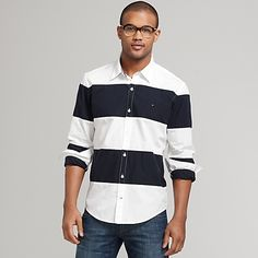 Tommy Hilfiger men's shirt. If there's a shirt anywhere with wider strips, we haven't seen it. Super broad and bold awning stripes are fresh and confident on crisp cotton. A nautical weekend comes to mind but this one has many more possibilities. Point collar with inside gingham trim. Long sleeves with button cuffs. Micro flag logo embroidered on chest. Button placket. Custom fit. 100% cotton. Machine washable. Imported.