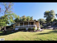 Perched on a hill that overlooks a natural landscape as the street name implies Overlook Drive. This well maintained manufactured home is nestled in aquiet area. Home boasts an open floor plan with 2 BR2 BA. Home sits on 1.43 acres that is mostly fenced with plenty of room for animals. There is alsoroom to store an RV boat or plant a garden. Enjoy nature and views from the covered front porch. Close to shopping entertainment (Black Oak Casino)and yet secluded. Dont miss out on this…