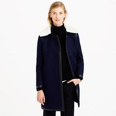 """We're not saying we're excited about the cold, but at least a frigid forecast means we can wear this coat. Our designers made it with a straight (not fitted) silhouette and topped it off with a collar in Italian shearling—the kind that's supersoft and <i>really</i> warm. Black leather trim gives it a little tough-girl edge; it's the kind of coat that says, """"Hey, I was cool way before the temperature dropped."""" <ul><li>Cut for a classic fit—not too loose and not too tight.</li><li>Body length…"""