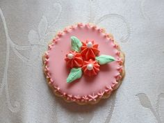 Hand-painted flower medallion sugar cookie in Coral