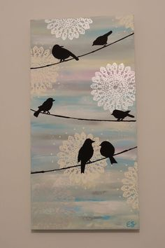 Birds on a wire. Acrylic on canvas. Blended random dabs of paint across canvas. Then stencilled doilies and painted on birds .: