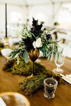 Modern wedding centerpiece idea - gold vessel with greenery arrangement and votive candles {K.L.W. Design Co.}