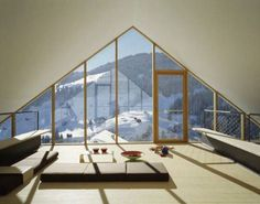 loft style living room overlooking snow covered mountains