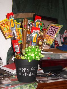 """Made this in March for my Dad's 60th Birthday... """"Man Flowers""""... beef jerky, cigars, lotto tickets, and mini bottles of Crown Royal and Jack Daniels.  :)"""
