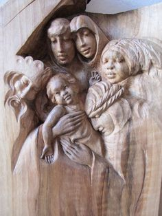 #Walnut #sculpture by #sculptor Martina Net�kov� titled: 'King of Kings (Wood Holy Family Wall statues/carving)'. #MartinaNet�kov�