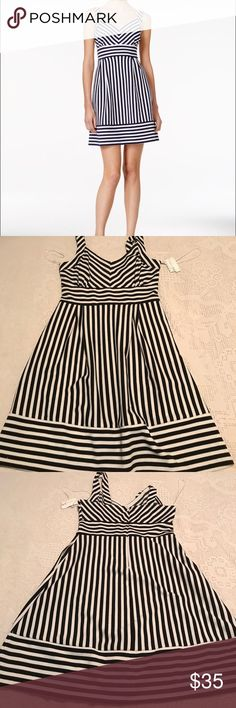 Maison Jules fit and flare dress NWT Adorable black and white fit and flare dress. Material is soft and washable!! Very flattering dress with pockets!! Maison Jules Dresses