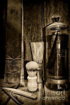 Shaving Strap, straight blade razor, comb in disinfectant..Old school Mens Barber Shop.