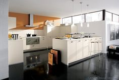 Idea of the Day: Modern creamy white kitchen with orange accent wall (By ALNO, AG) Beautiful Kitchen Designs, Best Kitchen Designs, Modern Kitchen Design, Beautiful Kitchens, Modern Kitchens, White Kitchens, Kitchen Cabinets Orange, Modern Kitchen Cabinets, Kitchen Flooring