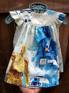 Star Wars Baby Dress 612 month Upcycled by BongaChopShop on Etsy, $54.00. Someone here must be a fan of both Star Wars and cute baby girl dresses, right? #baby