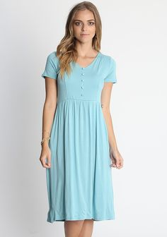 Blue midi dress with v-neckline, button up placket on chest, short sleeves and hidden side pockets. Unlined, opaque.  95% Rayon, 5% Spandex , Imported , 30