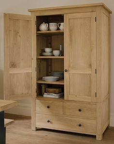 Store your dinnerware and linens in the Indigo Parlour Oak Cupboard. A delightful addition to your dining space. #parlourcupboard #oak #solidwood #diningroom #indigofurniture