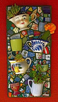 mosaic art by Jane Kelly, JK Mosaics, www.janekellymosaics.com What a creative way to display succulents!