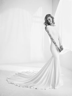 Rafaga: Mermaid style wedding dress, long sleeves and bateau neckline. Transparent, sexy and elegant back. Dress that slims the silhouette. Pronovias