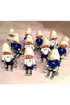 A charming group of 11 painted wood Christmas ornaments from Germany. The group is a collection of toy skiers hand painted with the main colors of blue, white, and silver. Our favorite part is their little crochet caps. Most of the pieces are in good condition, but there are a few that have lost their ski poles. SHOP http://www.heathertique.com/products/vintage-german-wood-ornaments-collection-of-11-blue-white-skiers-christmas-tree | Vintage Christmas Decor