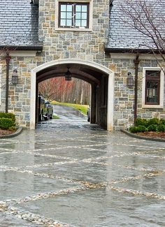 Favorite architectural feature: Porte cochere from Things that Inspire blog- love the stone work