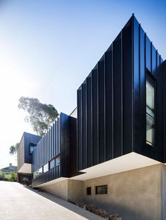 Mt Martha Beach House by Wolveridge Architects, on the Mornington Peninsula near Melbourne, is clad in a mixture of weather-resilient materials Zinc Cladding, Cladding Design, Exterior Cladding, Black House Exterior, Modern Exterior, Exterior Design, Facade Architecture, Residential Architecture, Facade House
