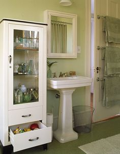 I love this vintage medical cabinet -- they make for wonderful storage. (my friend Melanie has one and I have LUSTED after it for years!)