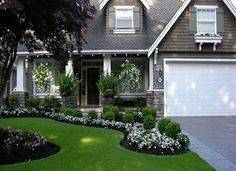 White with the rich green and gray draw your eyes to enjoy the yard's beauty.