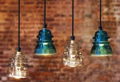 old glass insulators made into pendant lights - cool