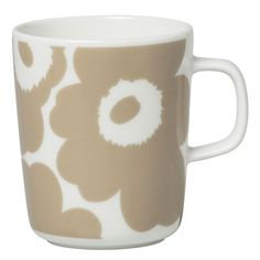 The Oiva mug features the Unikko (poppy) pattern in white and beige. It is made of white stoneware that is dishwasher, oven, microwave and freezer proof. Marimekko's famous poppy pattern Unikko was born in 1964 in a time when the design house' Marimekko, Nordic Interior Design, Poppy Pattern, Stoneware Mugs, White Beige, Mugs Set, Accessories Shop, Decoration, Signs