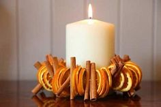 Thanksgiving decor / christmas decor dried orange peel Candle centerpiece For Thanksgiving This reminds me of the pomander craft they had us do in grade school! Orange Peel Candle, Dried Orange Peel, Dried Orange Slices, Dried Oranges, Dried Fruit, Noel Christmas, Christmas Crafts, Xmas, Christmas Oranges