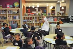 President Barack Obama raises his hand with a question during a visit to a pre-K class at Moravia Park Elementary School in Baltimore, May 17, 2013.