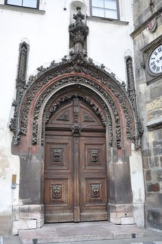 Beautiful door with elaborated tympanum and archivolts - Old Town City Hall by Jorge Lascar, via Flickr ~  Staré Město, Prague   ..rh