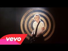 Have model in front of a large target, low focal length to get some fisheye, have arrows hit the target, as well as into the model, with one in the heart. __ Brody Dalle - Don't Mess With Me - YouTube