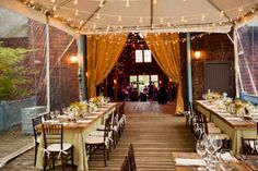 We installed this tent straight off a barn and added wood floor to match.  Guests dined at our farm top tables!