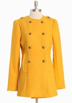 Marigold coat is finished with a chic double-breasted closure, button-tabbed shoulders with ruched detail, and side pockets.