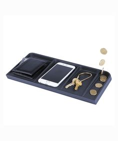 Le Videpoche Valet Tray By Doiy Is For Your Everyday Carry, With Four Open Compartments and Grooves That Are in the Shape of a Wallet, Phone, Key and Coins.