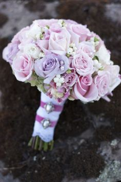 Love this feminine lavender & soft pink bouquet! Created with light pink roses, lavender roses, white snowberries and pink lisianthus. by Botanica Floral Designs.