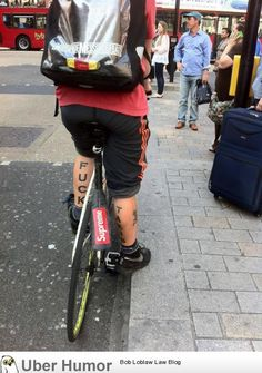 Spotted this guy cycling through London. Best bike messenger tattoo ever? - http://geekstumbles.com/funny/uber-humor/spotted-this-guy-cycling-through-london-best-bike-messenger-tattoo-ever/