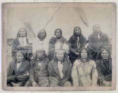 Title: Indian chiefs who counciled with Gen. Miles and setteled [sic] the Indian War -- 1. Standing Bull, 2. Bear Who Looks Back Running [Stands and Looks Back], 3. Has the Big White Horse, 4. White Tail, 5. Liver [Living] Bear, 6. Little Thunder, 7. Bull Dog, 8. High Hawk, 9. Lame, 10. Eagle Pipe Group portrait of Lakota chiefs, five standing and five sitting with tipi in background--probably on or near Pine Ridge Indian Reservation. 1891. Repository: Library of Congress Prints and Photographs